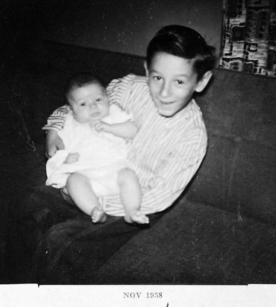 George holding Normie 1958.JPG
