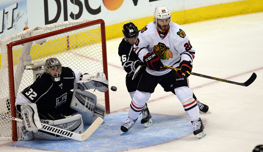 . Kings goalie Jonathan Quick #32 keeps his guys on the puck as the Blackhawks� Brandon Saad #20 looks for the shot during Game 6 of the Western Conference finals at the Staples Center on Friday, May 30, 2014. (Photo by Hans Gutknecht/Los Angeles Daily News)