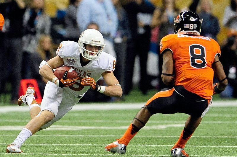 . Jaxon Shipley #8 of the University of Texas Longhorns is pursued by Tyrequek Zimmerman #8 of the Oregon State Beavers during the Valero Alamo Bowl at the Alamodome on December 29, 2012 in San Antonio, Texas.  (Photo by Stacy Revere/Getty Images)