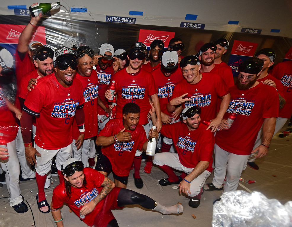. Members of the Cleveland Indians celebrate in the clubhouse after the Indians defeated the Detroit Tigers 15-0 to clinch the American League Central Division, in a baseball game, Saturday, Sept.15, 2018, in Cleveland. (AP Photo/David Dermer)