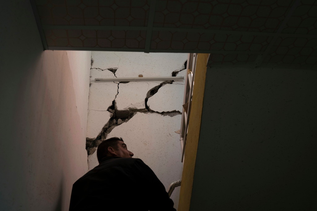 . A man checks the interior of a damaged house after an earthquake in the city of Darbandikhan, northern Iraq, Monday, Nov. 13, 2017. Authorities reported that a powerful 7.3 magnitude earthquake struck the Iraq-Iran border region on Monday and killed more than three hundred people in both countries, sent people fleeing their homes into the night and was felt far west as the Mediterranean coast. (AP Photo/Felipe Dana)