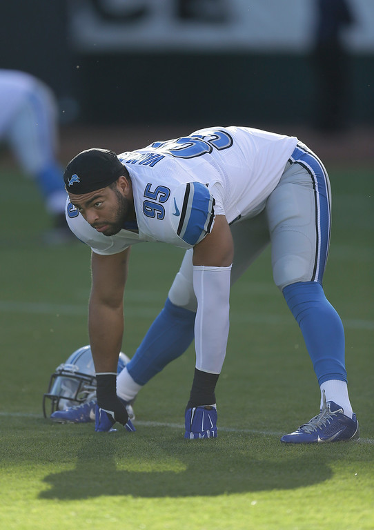 . Detroit Lions outside linebacker Kyle Van Noy (95) warms up before an NFL preseason football game against the Oakland Raiders in Oakland, Calif., Friday, Aug. 15, 2014. (AP Photo/Ben Margot)