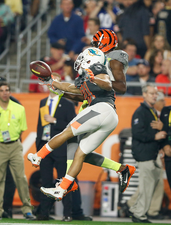 . GLENDALE, AZ - JANUARY 25: Team Carter wide receiver A.J. Green #18 of the Cincinnati Bengals can\'t haul in a pass over Team Irvin cornerback Brent Grimes #21 of the Miami Dolphins during the first half of the 2015 Pro Bowl at University of Phoenix Stadium on January 25, 2015 in Glendale, Arizona.  (Photo by Christian Petersen/Getty Images)