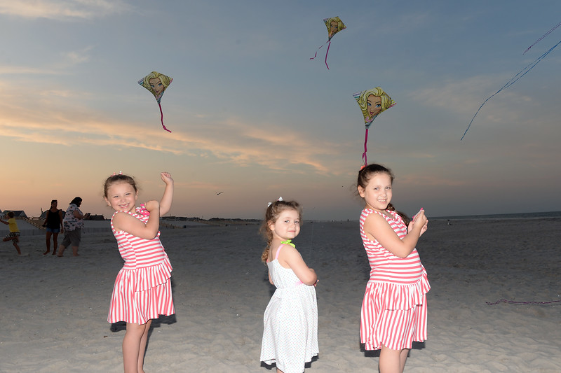 Sisters Alexandra, Gabriella, and Isabella Delligatti with their kites at the Kites and Castles event on the Beach in Lavallette, NJ on 08/01/2019.(STEVE WEXLER/THE OCEAN STAR).