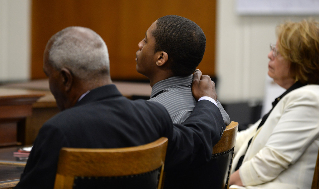 . Defense attorney Gordon Brown puts his arm on the shoulder of defendant Marcelles Peter during the reading of the verdict at the Wakefield-Taylor courthouse in Martinez, Calif., on Thursday, July 18, 2013. Two separate verdicts were read in the Richmond High gang rape trials Marcelles Peter and Jose Montano with Judge Barbara Zuniga presiding. Juries in both cases brought back guilty verdicts. (Dan Honda/Bay Area News Group)