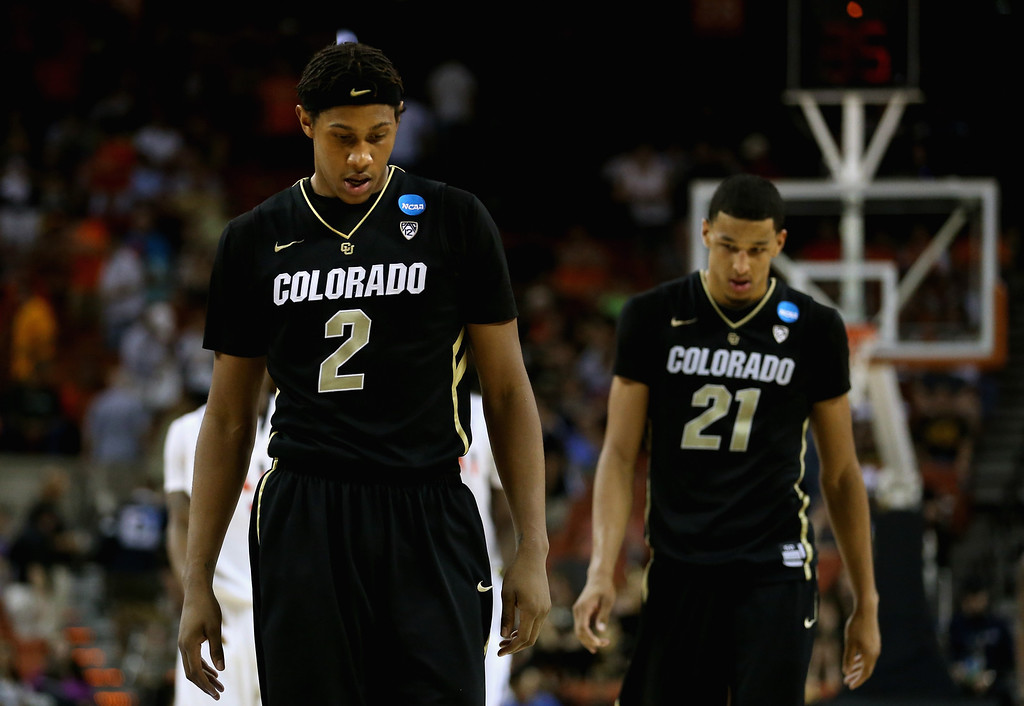 . AUSTIN, TX - MARCH 22: Xavier Johnson #2 and Andre Roberson #21 of the Colorado Buffaloes walk on the court in the final minutes of the game against the Illinois Fighting Illini during the second round of the 2013 NCAA Men\'s Basketball Tournament at The Frank Erwin Center on March 22, 2013 in Austin, Texas. Illinois defeated Colorado 57-49. (Photo by Ronald Martinez/Getty Images)