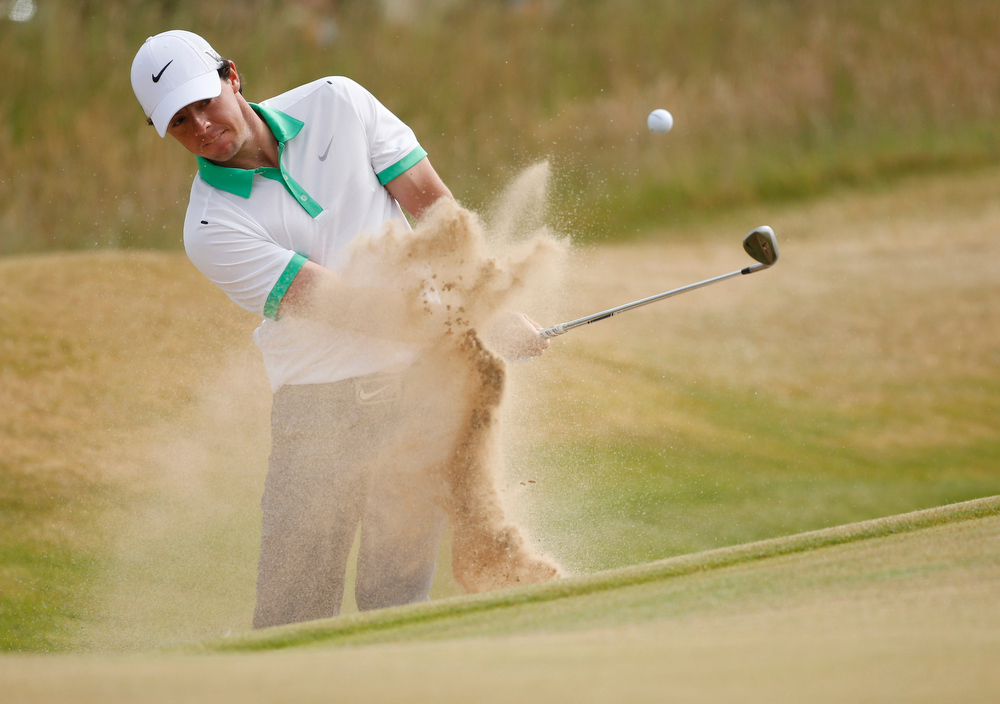 . Rory McIlroy of Northern Ireland plays a shot onto the first green during the first round of the British Open Golf Championship at Muirfield, Scotland, Thursday July 18, 2013. (AP Photo/Peter Morrison)