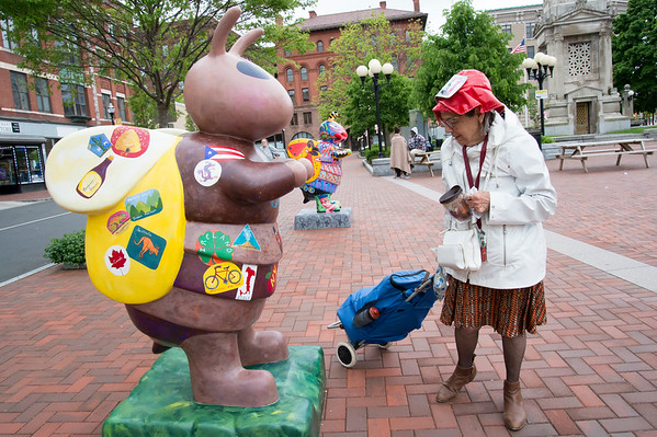 05/14/19 Wesley Bunnell | Staff Joan Morgan looks over an artist decorated bee currently on display in Central Park on Tuesday afternoon. The display is a preview of the Bees Across New Britain art project with several more statues being painted.