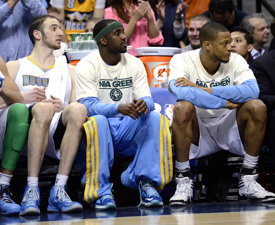 . Denver Nuggets Ty Lawson (center) sits on the bench during the fourth quarter against the San Antonio Spurs April 10, 2013 at Pepsi Center. (Photo By John Leyba/The Denver Post)
