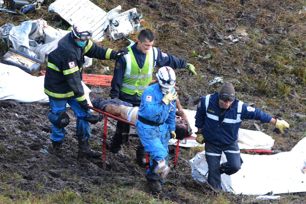 . EDS NOTE: GRAPHIC CONTENT - Rescue workers recover a body from the wreckage site of an airplane crash, in La Union, a mountainous area near Medellin, Colombia, Tuesday , Nov. 29, 2016. The chartered plane was carrying a Brazilian soccer team to the biggest match of its history when it crashed into a Colombian hillside and broke into pieces, killing 75 people and leaving six survivors, Colombian officials said Tuesday. (AP Photo/Luis Benavides)