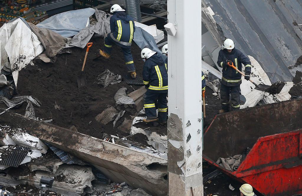 . Rescue workers search the debris of the Maxima supermarket in Riga,  Latvia, Saturday, Nov. 23, 2013. (AP Photo/Mindaugas Kulbis)