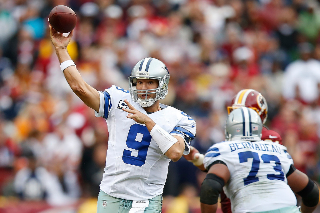 . Dallas Cowboys quarterback Tony Romo passes the ball during the first half of an NFL football game against the Washington Redskins in Landover, Md., Sunday, Dec. 22, 2013. (AP Photo/Evan Vucci)