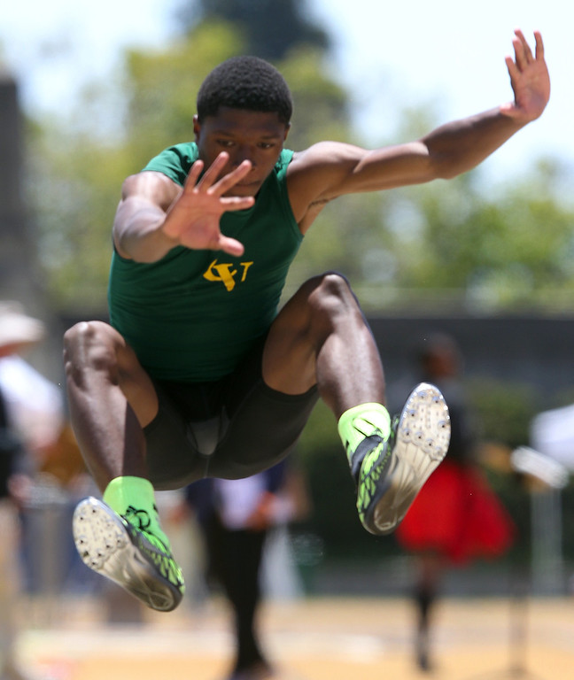 . Castro Valley\'s Nate Moore competes in the boys long jump at the North Coast Section Meet of Champions at Cal\'s Edwards Stadium in Berkeley, Calif., on Saturday, May 25, 2013. Wallace placed first. Moore placed second. (Anda Chu/Bay Area News Group)
