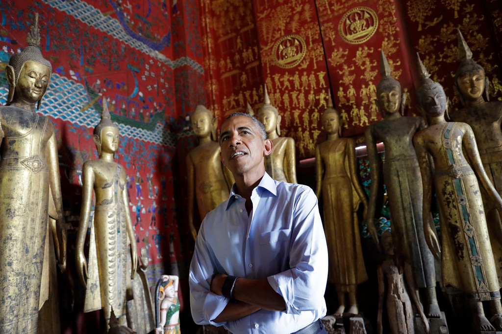 . U.S. President Barack Obama pauses in the Ho Raj Rod, or Carriage House, as he tours the Wat Xieng Thong Buddhist Temple in Luang Prabang, Laos, Wednesday, Sept. 7, 2016. (AP Photo/Carolyn Kaster)