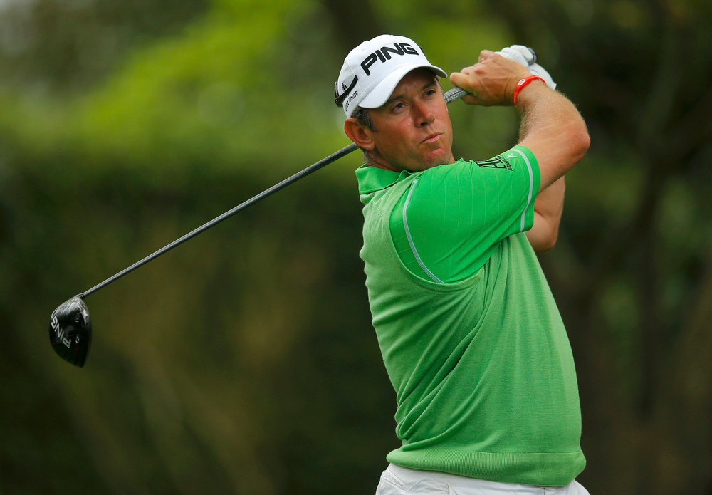 . Lee Westwood of England watches his tee shot on the second hole during first round play in the 2013 Masters golf tournament at the Augusta National Golf Club in Augusta, Georgia, April 11, 2013.  REUTERS/Brian Snyder