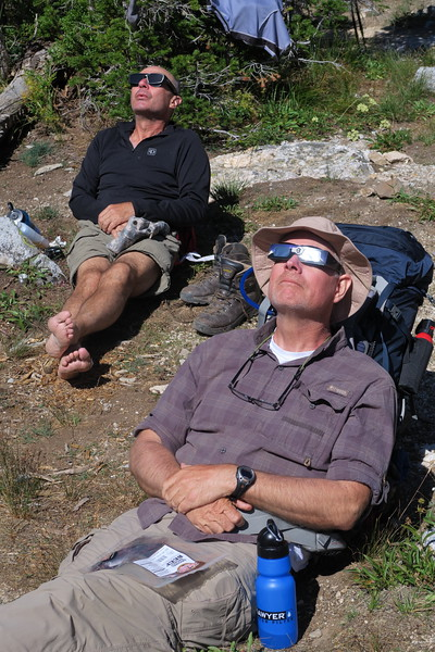 Andy goes shoeless as Greg prepares for the total eclipse of the sun in South Cascade Canyon