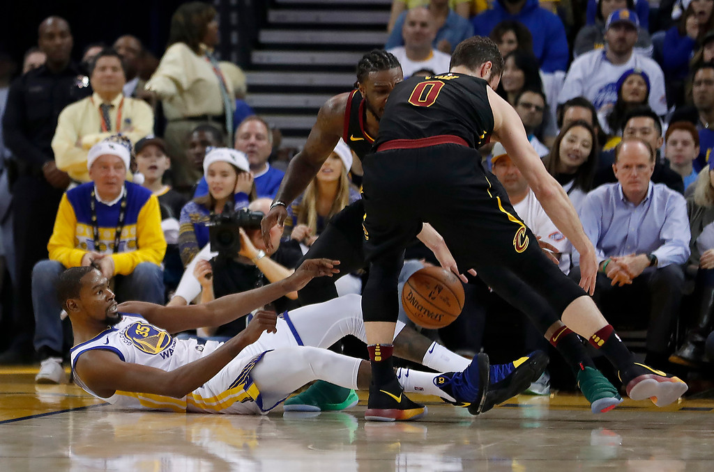 . Cleveland Cavaliers forward Kevin Love (0) steals the ball from Golden State Warriors forward Kevin Durant (35) during the first half of an NBA basketball game in Oakland, Calif., Monday, Dec. 25, 2017. (AP Photo/Tony Avelar)