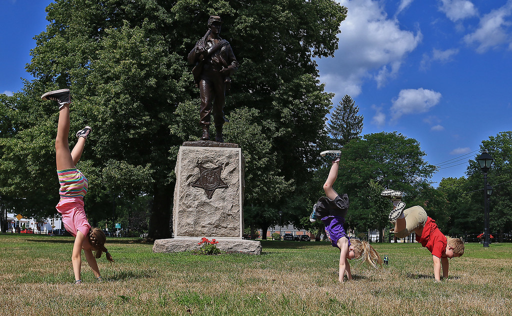 . From left doing cartwheels on the Townsend Common is siblings Jordan Andre, 12, and twins Mikayla and Logan, 7. They just moved to Townsend and where checking out the sites and the town. SENTINEL & ENTERPRISE/JOHN LOVE