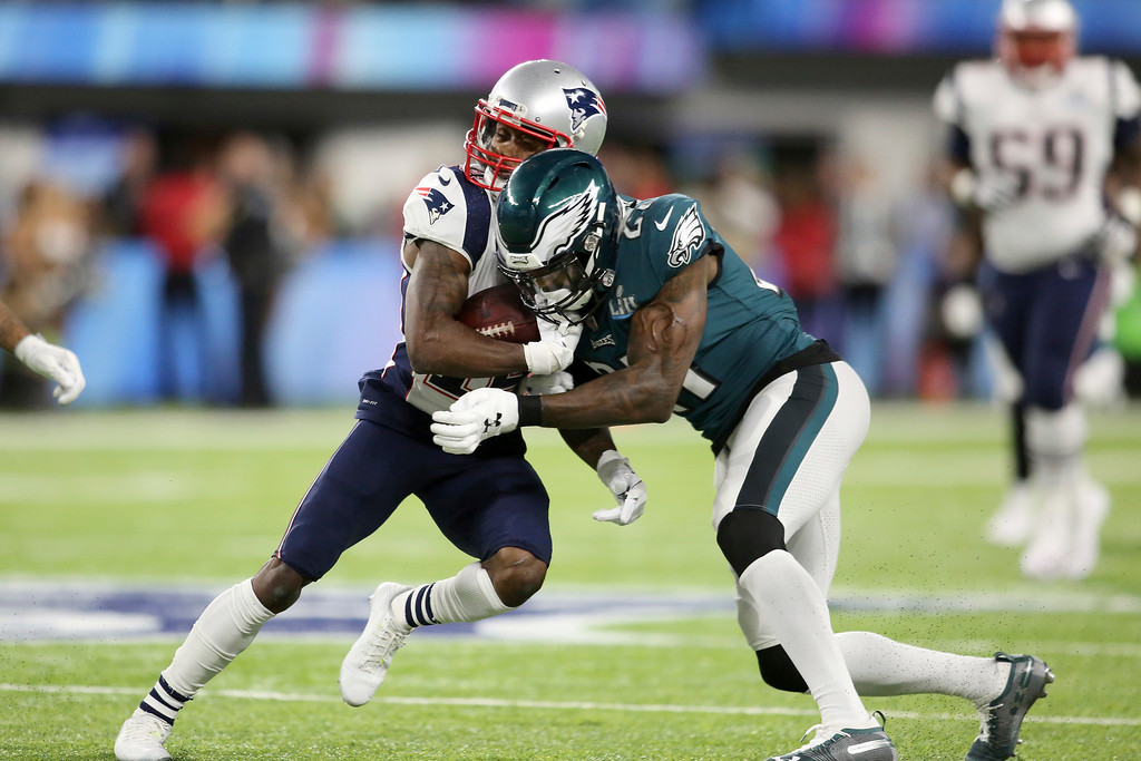 . New England Patriots receiver Brandin Cooks gets hit by Philadelphia Eagles safety Malcolm Jenkins during the first half of Super Bowl 52 on Sunday, February 4, 2018 in Minneapolis. (AP Photo/Gregory Payan)