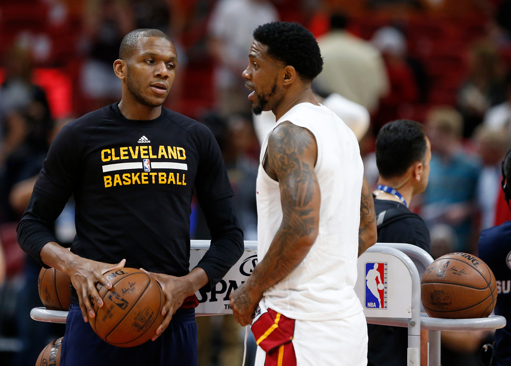 . Cleveland Cavaliers guard James Jones, left, chats with Miami Heat forward Udonis Haslem before the start of an NBA basketball game, Monday, April 10, 2017, in Miami. (AP Photo/Wilfredo Lee)