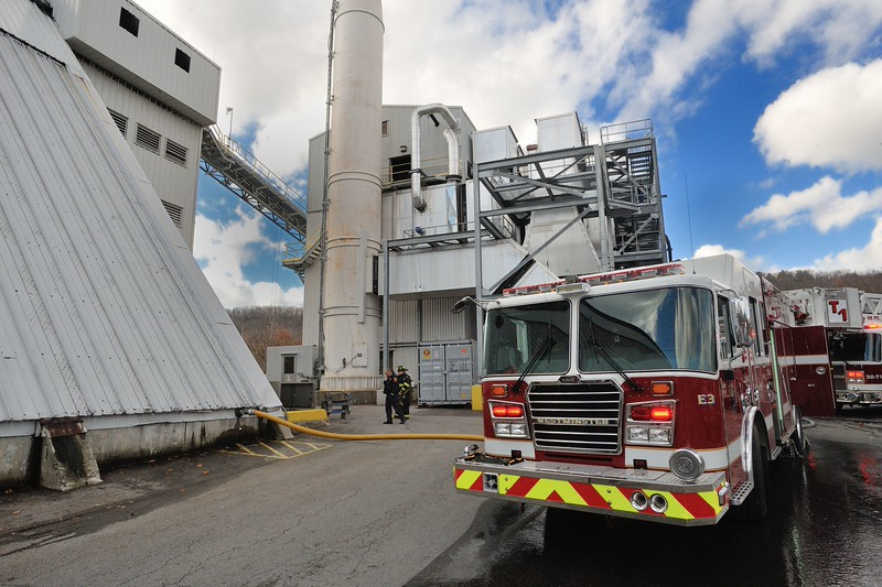 Westminister Fire Chief Kevin Nivala (left rear) directs crews during a 1st Alm fire at Pine Tree Power on Rowtier Dr. Embers from soldering ignited woodchips inside the plant.