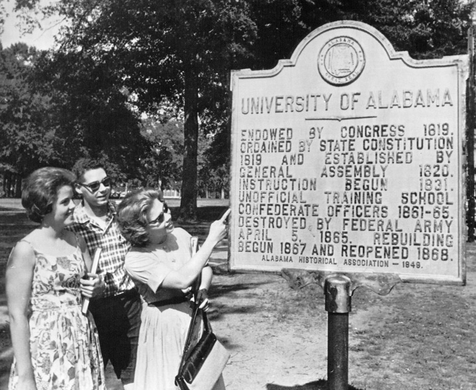 . Students look at a plaque on campus at the University of Alabama in Tuscaloosa that tells the story of the school. Vivian Malone will try to register at the university on June 10 to become the second black student to be admitted to the school since it was founded in 1831. 1963