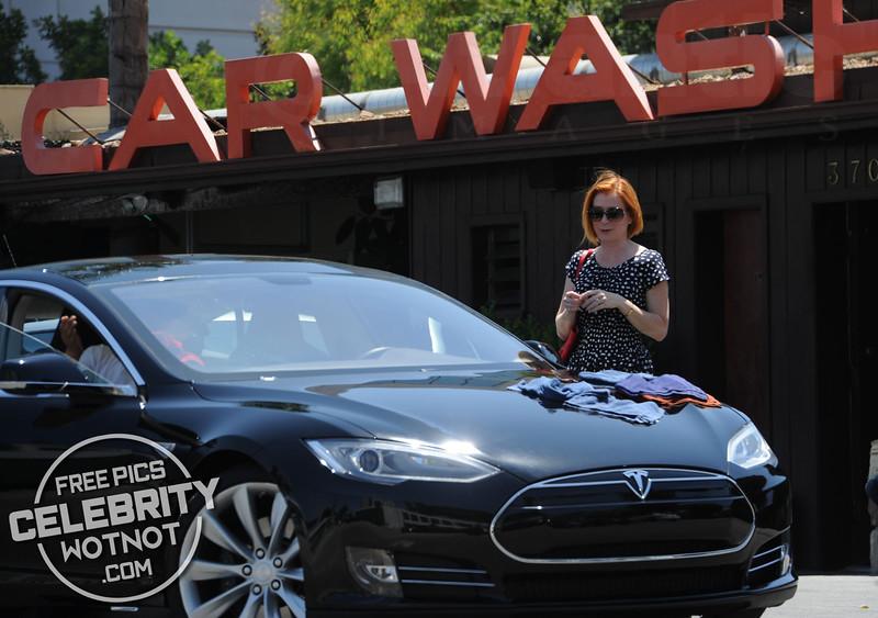 EXC: Alyson Hannigan Takes Tesla To The Car Wash