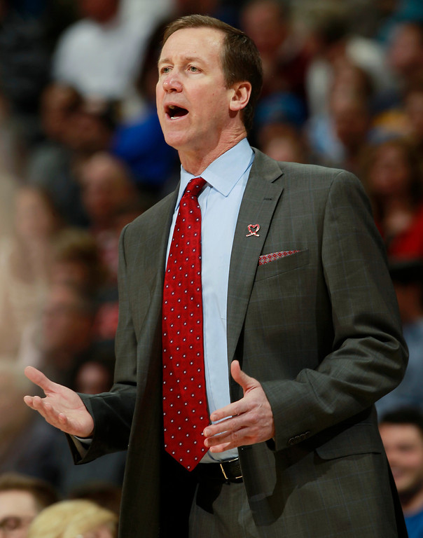 . Portland Trail Blazers head coach Terry Stotts directs his team against the Denver Nuggets in the first quarter of an NBA basketball game in Denver, Tuesday, Feb. 25, 2014. (AP Photo/David Zalubowski)
