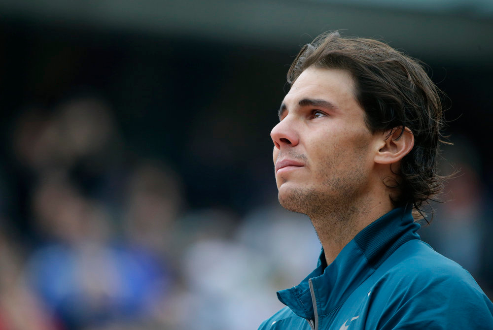 . Spain\'s Rafael Nadal listen to his national anthem during the trophy ceremony after he won the 2013 French tennis Open final against Spain\'s David Ferrer at the Roland Garros stadium in Paris on June 9, 2013. KENZO TRIBOUILLARD/AFP/Getty Images