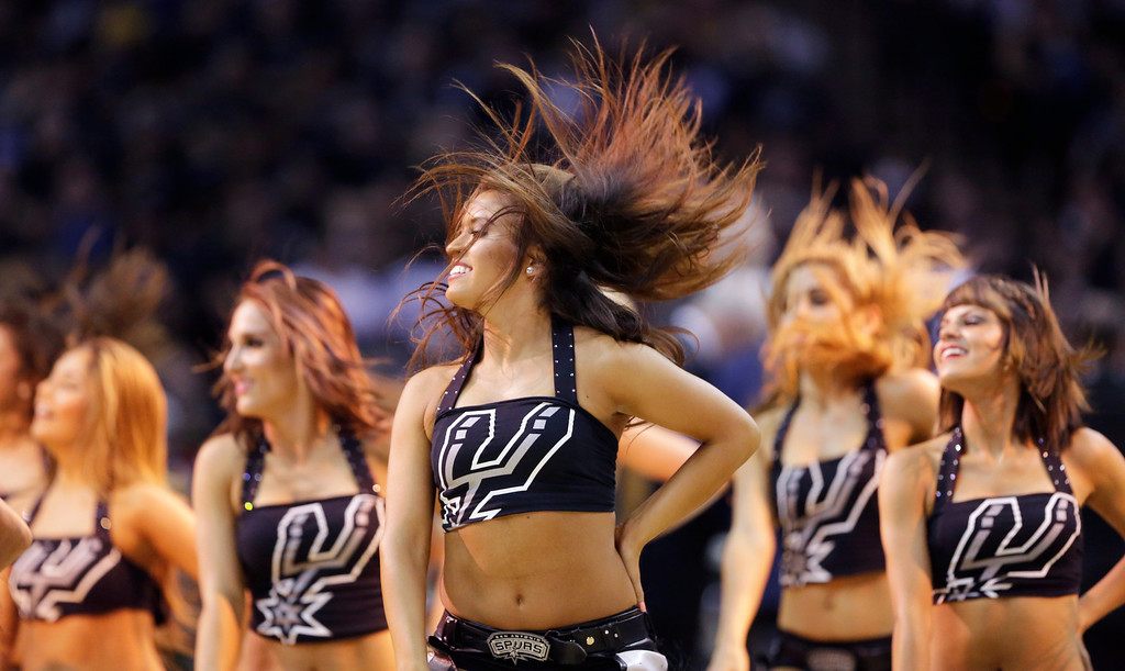 . San Antonio Spurs cheerleaders perform during the first half in Game 1 against the Miami Heatof the NBA basketball finals on Thursday, June 5, 2014, in San Antonio. (AP Photo/Eric Gay)