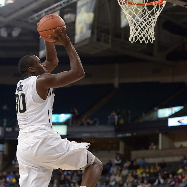 Travis McKie goes in for dunk.jpg