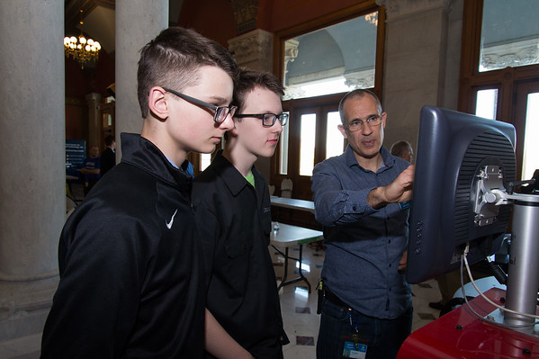 04/24/19 Wesley Bunnell | Staff A Student-Manufacturer Connection Fair was held on Wednesday at the State Capitol Building connecting over 500 students and dozens of Connecticut companies to explore careers in advanced manufacturing. Goodwin College's Assistant Professor in Welding Technology Jason Sagaci, R, explains the workings of a welding training simulator to Xavier High students Spencer Thompson and Aidan Muldoon.