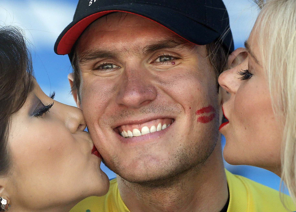. Tejay Van Garderen gets kissed on the podium after winning the Tour of California cycling race in Santa Rosa, Calif., Sunday, May 19, 2013. (AP Photo/Marcio Jose Sanchez)