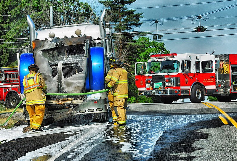 Jack Haley/Messenger Post Media Firefighters from Victor and Fishers responded to a tractor trailer on fire on County Road 41 just east of Route 444 late Wednesday morning.