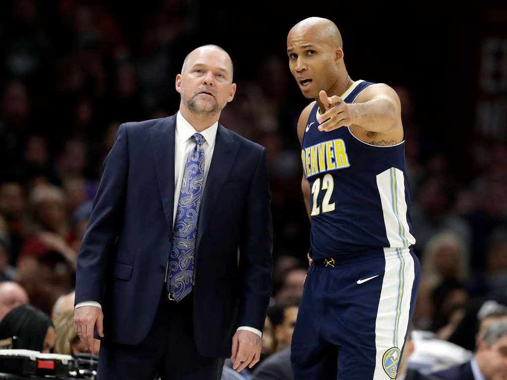 . Denver Nuggets head coach Michael Malone, left, talks with Richard Jefferson in the first half of an NBA basketball game against the Cleveland Cavaliers, Saturday, March 3, 2018, in Cleveland. The Nuggets won 126-117. (AP Photo/Tony Dejak)