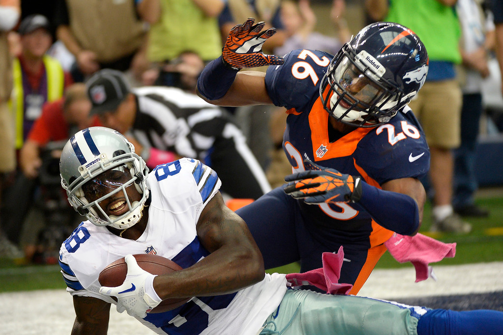 . Wide receiver Dez Bryant #88 of the Dallas Cowboys pulls in a catch in front of free safety Rahim Moore #26 of the Denver Broncos to make the score 6-0. (Photo By Joe Amon/The Denver Post)
