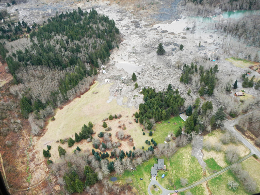 . In this handout from Washington State Dept of Transportation, an aerial of a mudslide that covered SR 530 March 22, 2014 between Darrington and Arlington, Washington.  (Photo by Washington State Dept of Transportation via Getty Images)