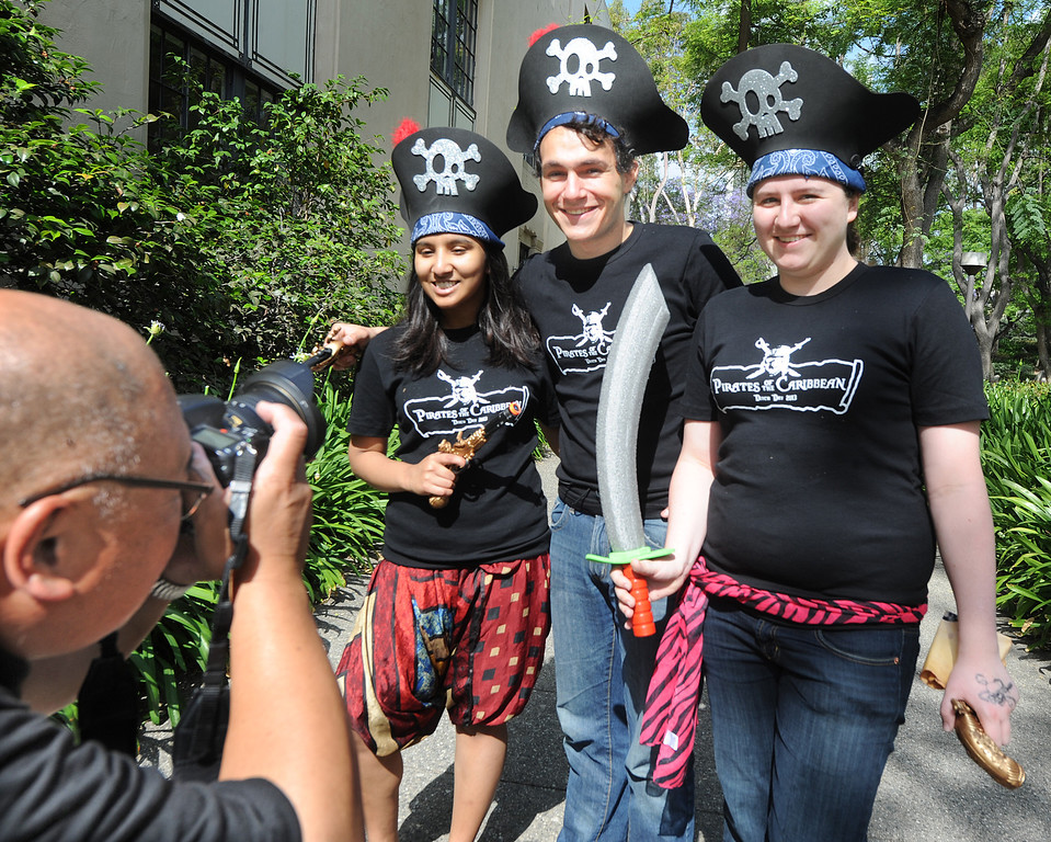 . Caltech students Prastuti Singh, left, Jetson Leder-Luis, and Brooklyn Schlamp from Ricketts House pose for a photo for Robert Paz, dressed as Pirates of Caribean.  A fun-filled day of antics and escapades, Ditch Day is one of Caltech�s oldest traditions � a cross between Animal House and a science fair! Friday, May 24, 2013. Caltech seniors ditch their classes while underclassmen devote their entire day to quirky pranks and attempting to solve elaborate puzzles, mazes, quests, and other challenging hijinks that seniors have devised and left behind for them.This year�s activities include a laser maze, sledgehammer brick building demolition, shopping cart race, sumo tournament, roof rappelling, hovercraft human bowling, teleportation and time-travel puzzles, and much more.(SGVN/Photo by Walt Mancini)