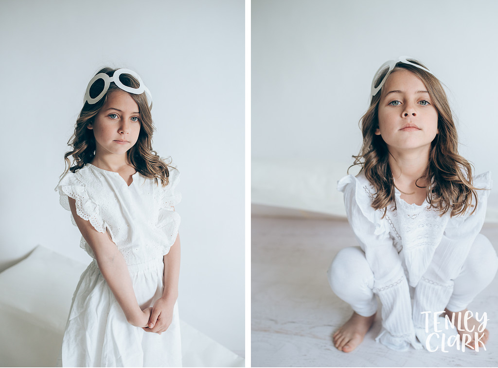Whimsical kid's fashion editorial with giant white paper origami props. Photography by Tenley Clark.