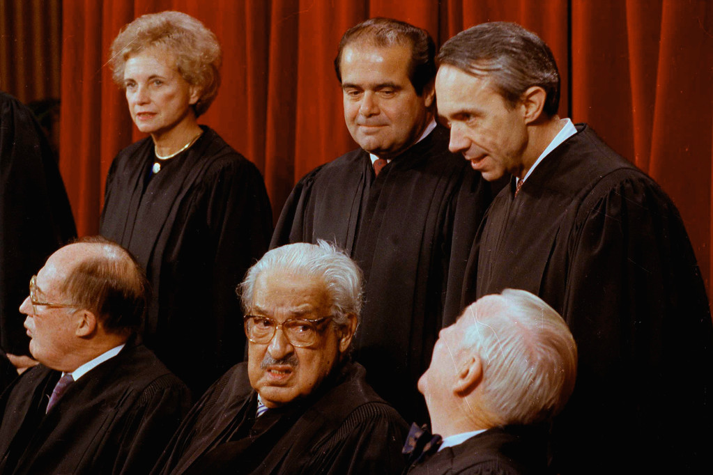 . FILE � In this Nov. 9, 1990, file photo U.S. Supreme Court justices pose for a group portrait at the court in Washington. Clockwise from top left are Justice Sandra Day O\'Connor, Antonin Scalia, David Souter, John Paul Stevens, Thurgood Marshall, and Chief Justice William Rehnquist. Years later O\'Connor, the first woman ever to serve on the court, would say of Marshall, the first African-American to serve on the court, that he �imparted not only his legal acumen but also his life experiences, constantly pushing and prodding us to respond not only to the persuasiveness of legal argument but also to the power of moral truth. (AP Photo/Bob Daugherty, File)