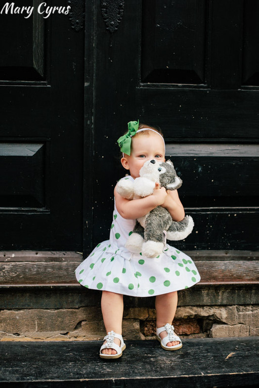 18-Month-Old Lorelai & her stuffed animal Husky in Downtown McKinney, Texas. Photo by Mary Cyrus - Portraits & Weddings in Dallas & Beyond.
