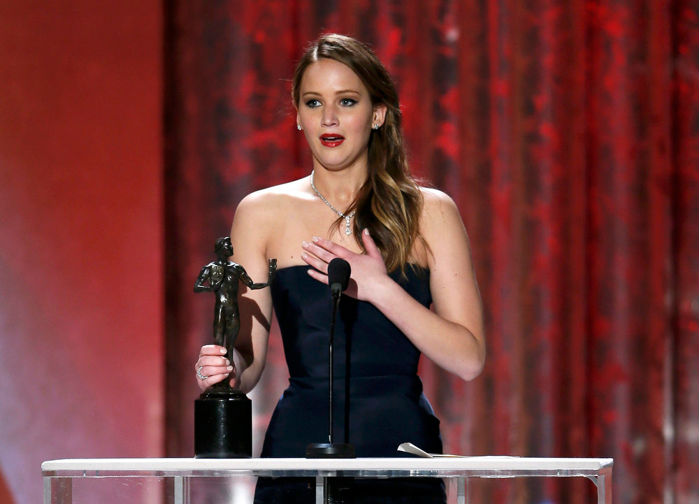 ". Jennifer Lawrence accepts the award for outstanding female actor in a leading role for ""Silver Linings Playbook\"" at the 19th annual Screen Actors Guild Awards in Los Angeles, California January 27, 2013.    REUTERS/Lucy Nicholson"