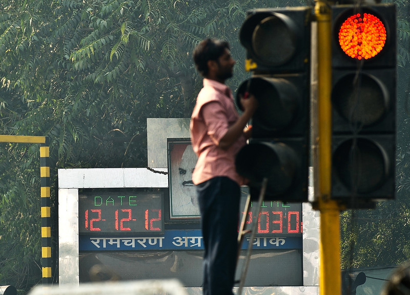 . An electronic clock displays the date 12.12.12 as an Indian man repairs traffic light at an intersection in New Delhi on December 12, 2012. The once in a century date is being hailed as an auspicious day by astrologers, and many couples are getting married and expectant parents are flooding maternity homes, inundating doctors with requests to deliver their babies.  MANAN VATSYAYANA/AFP/Getty Images