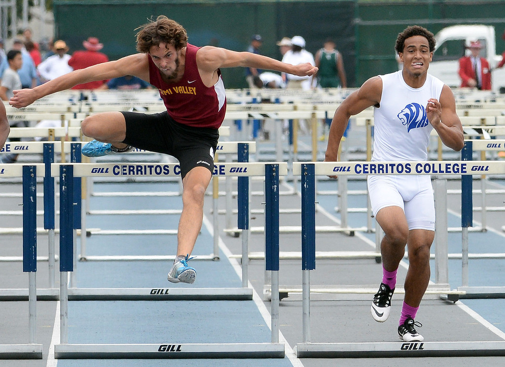 . Simi Valley\'s Alex Billin, left, wins the division 2 110 meter high hurdles during the CIF Southern Section track and final Championships at Cerritos College in Norwalk, Calif., Saturday, May 24, 2014.   (Keith Birmingham/Pasadena Star-News)