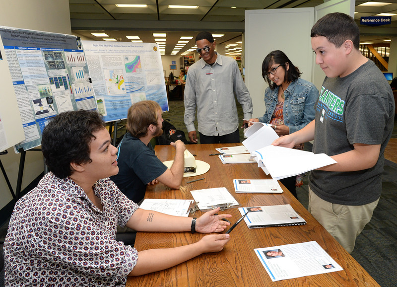 students-learn-about-research-opportunities-available-through-the-mcnair-scholars-program-during-the-mcnair-journal-signing-event_15015189510_o.jpg