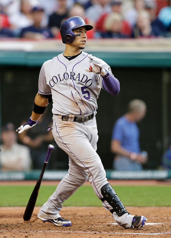 . Colorado Rockies\' Carlos Gonzalez watches his two-run home run off Cleveland Indians starting pitcher Corey Kluber in the fourth inning of a baseball game Friday, May 30, 2014, in Cleveland. (AP Photo/Mark Duncan)