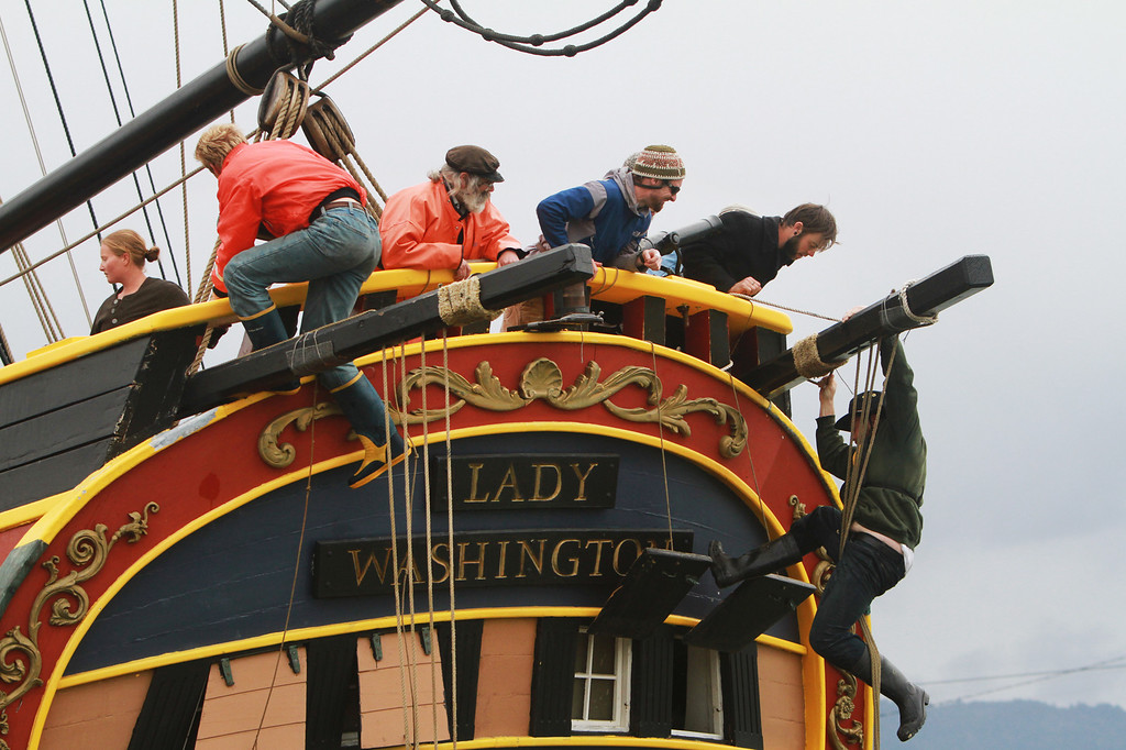 . Crew members climb up the stern of the Lady Washington, a replica of an 18th century tall ship, at the Port of Redwood City on Thursday, March 7, 2013. The Lady Washington is one of two historical ships that will visit the port and be open for public tours, sailing excursions, and educational programs starting today, Friday, March 8, 2013. The Hawaiian Chieftain and the Lady Washington will be at the Redwood City port until March 19. For more information, visit http://www.redwoodcityport.com/. (Kirstina Sangsahachart/ Daily News)