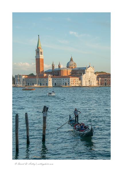 Gondolier and San Giorgio Maggiore, Venice, Italy