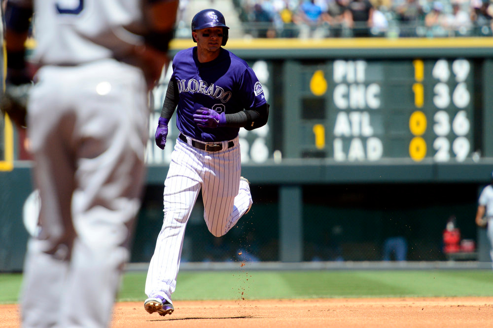 . Colorado Rockies shortstop Troy Tulowitzki (2) rounds the bases after hitting a two-run home run off of San Diego Padres starting pitcher Clayton Richard (33) during the first inning in Denver. The Colorado Rockies hosted the San Diego Padres at Coors Field on Sunday, June 9, 2013. (Photo by AAron Ontiveroz/The Denver Post)