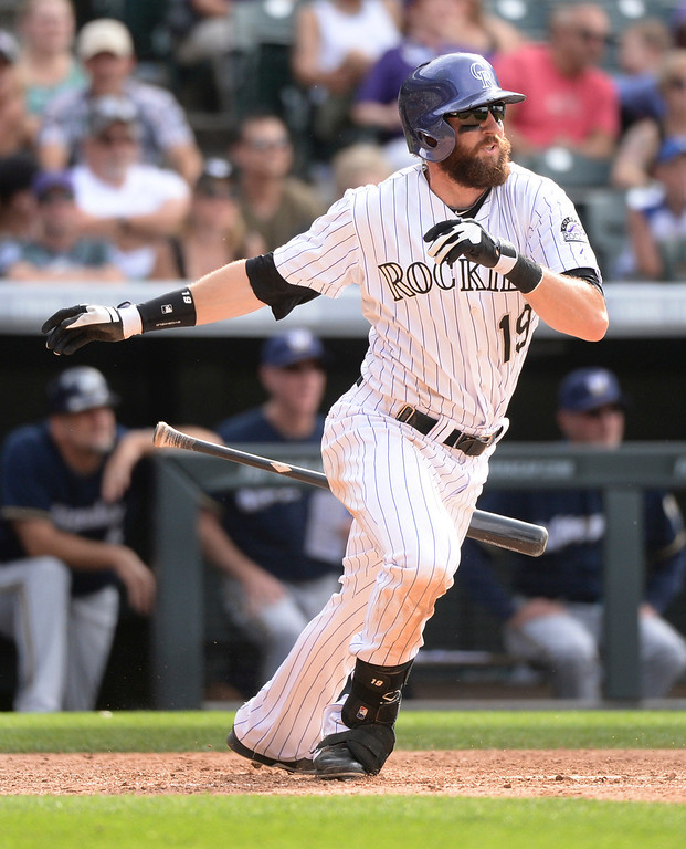 . DENVER, CO - JUNE 20: Colorado batter Charlie Blackmon dropped his bat and ran out of the batters box in the ninth inning but made the final out. The Milwaukee Brewers defeated the Colorado Rockies 9-4 at Coors Field Saturday afternoon, June 21, 2014. Photo by Karl Gehring/The Denver Post